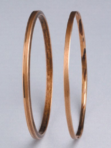 Figure 3: A new oil ring (left) and a badly worn oil ring (right). Oil rings tend to abrade; the abraded particles cause bearing distress (Photo courtesy of TRICO Corporation, Pewaukee, Wisconsin)